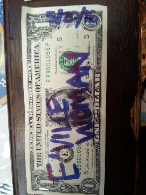 scottsville eville woman dollar bill